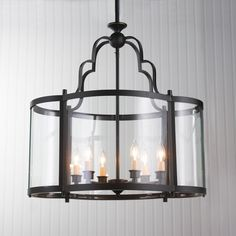 Oval Quatrefoil Lantern - Large A new twist on a classic glass conservatory lantern, this oval shaped light has curved glass panels that form a quatrefoil shape within the blackened Bronze frame.