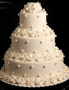 Classic ivory Demi roses & pearls wedding cake. Traditional & timeless.