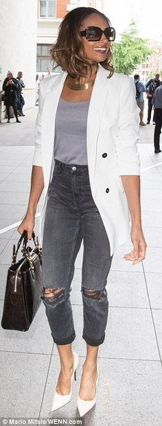 City chic: She styled her sartorial choice further with a plain grey T-shirt, a statement ...