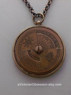 Beautiful brass 50 year Nautical Calendar. This is a Vintage style Metal Pendant. Worn beautiful patina. This 50 year calendar is unique.  This has a dial on the front to put the date, time , year and month in sinc.  Hanging from a 22 inch figaro brass chain.  This piece was used by Seaman to help them keep track of the days when they were out to sea for long periods of time.  This really cool piece is brass with a beautiful patina. You turn the dial on the front and it will tell you the…