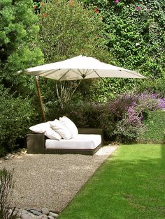 I like this lounge and umbrella. That would be a nice place to sit in the back yard.