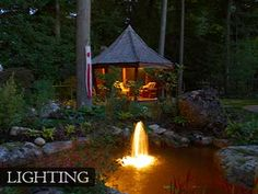 Use of lighting hilights and extends the life of many outdoor entertainment areas.  This illuminated pond reflects the movement of the fish and the bubbling water feature has a life of it's own.