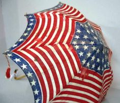 This small umbrella was probably a political campaign souvenir. Red, white and blue stripes and stars with beaded tassels and a bamboo shaft. It sold at auction in 2005 for $381.88.