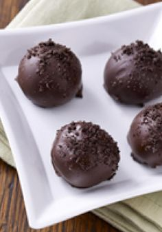 Easy Chocolate Cookie Truffles — This is the stuff that dessert dreams are made of: Chocolate cookie crumbs are blended with cream cheese and covered with a chocolate shell. They make a great edible Christmas gift, too!