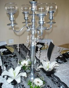 Individual flowers add simplicity but style surrounding a candelabra base. Via FloristChronicles.com.