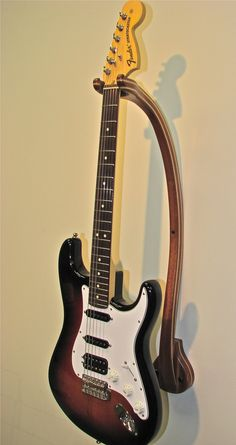 Wall Guitar Stand. This may be purchased on ecofirstart.com