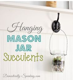 Hanging Mason Jar filled with shells for drainage and succulents