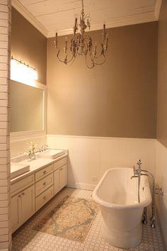 The Farmhouse - Magnolia Homes Beautiful bathroom!! Love the beadboard and tile floor.