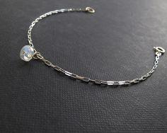 moonstone bracelet, sterling silver box chain with grade AAA rainbow moonstone charm bracelet, sterling silver bracelet, big moonstone charm by sticksandstonesny on Etsy https://www.etsy.com/uk/listing/203138022/moonstone-bracelet-sterling-silver-box