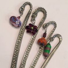 Pewter and glass bookmarks.