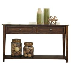 Cordelia Console Table A timeless addition to your living room or den, this stylish console table showcases antiqued brass hardware and a rich dark hazelnut finish.
