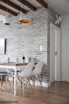 One or two walls of brick, are very common in this arrangement. It looks a bit rustic, but at the same time modern.
