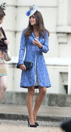 Kate wore a stunning blue patterned Jane Troughtoncoat to a friend's wedding, paired with a Jane Corbett fascinator and black court shoes. via StyleListCanada