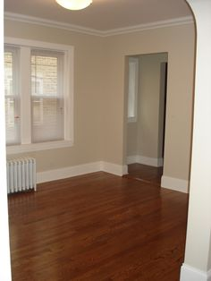 """Benjamin Moore Sail Cloth Paint Color in a room with better lighting / Minwax """"Special Walnut"""" floor stain - color for our hallway Sail Cloth Benjamin Moore, Benjamin Moore White Sand, Benjamin Moore Paint, Best Paint Colors, Paint Colors For Home, Wall Colors, House Colors, Paint Colours, Red Oak Floors"""