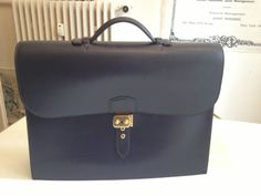 as a lawyer I need a briefcase as you can imagine :-) ..this is my beloved Hermes Sac a depeches..love it!