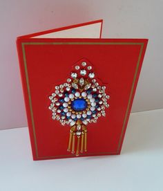 This is a highly collectable Christmas Card.  It dates to 1976 and consists of a decorative design on the front, printed Festive dedication on the inside - and also signed by the famous dress designer, Norman Hartnell (1901 - 1979).  Norman Hartnell was a leading British fashion designer, best known for his work for the ladies of the Royal Family. He gained the Royal Warrant as Dressmaker to Queen Elizabeth The Queen Mother in 1940; and Royal Warrant as Dressmaker to Queen Elizabeth II in…