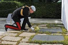 Prince Harry visits the graves of JFK and Jackie Kennedy at Arlington Cemetery.
