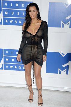 Woke up like this: Kim Kardashian rocked sexy wet-look hair and a semi-sheer…