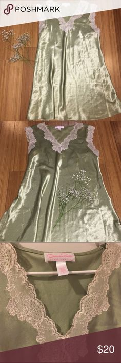 """Gorgeous Oscar de La Renta Slip Dress Gorgeousssss Lingerie Piece 🤤 Wear it as a nighty or out as a slip dress. Pale sage green with cream colored lace trim around the sleeves and bust. Satin material. Excellent condition. Size L. 35"""" in length. Pit to pit: 18"""".      ➡️ Purchase on Depop to save $$ on shipping & price.  Depop: @babyspicevintage Oscar de la Renta Intimates & Sleepwear"""