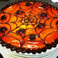 Ooey, gooey, bloody... Orange! Chocolatey, spooky, goodness! All in one cake. What else could you want for Halloween? #halloween #bloodorange #spiders #chocolate #spiderweb #creepy #delicious #boulder #colorado #orange #spooky #cake #torte #chocolatecake #mousse #buttercream