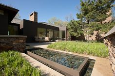 Infinite water pool display. Smooth river stones and gravel naturally clean the water.