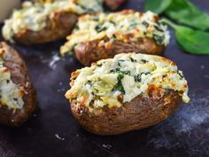 Potato chips with spinach and artichoke dip is quintessential party food, but swap out the chips for ultimate baked potatoes, and suddenly the combination is perfect for a weekday dinner. By scooping out the potato flesh and mashing it with the dip before re-stuffing, you get a ton of flavor in every bite of baked potato.