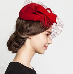 Fascinators bow pillbox hat with veil for women. I would love to buy this hat probably in brown or black, although the red is fabulous. It's held in place with a hidden headband. $49.99.