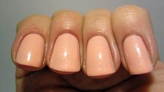 Nordic Cap's number 14 is a pale peachy pink (a tad more pink IRL) polish full of white shimmer. The application was decent, it needed three coats for opacity