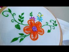 Hand Embroidery: Twisted Chain Flower Stitch - Shagufta Fyms on YouTube.  [This channel is wonderful for seeing embroidery techniques.]