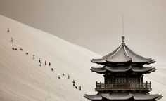 Tourists Climb the Singing Sand Dunes near Crescent Moon Spring in Gansu Province. 7/10.