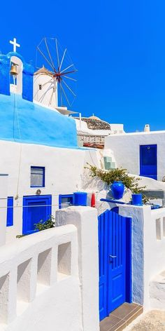 Typical Greek houses and windmill on street of Oia village, Santorini island, Greece Vacation Places, Dream Vacations, Places To Travel, Places Around The World, Travel Around The World, Around The Worlds, Beautiful World, Beautiful Places, Greek Decor