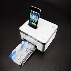 "$139.00 - This small and compact printer and charging station takes electronic innovation to a whole new level. All you need to do is dock, view, and print gorgeous 4""x6"" photos directly from a docked iPhone or iPod without the need for a computer."