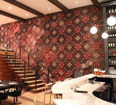 Full wall cross-stitch installation at Patria Restaurant in Toronto