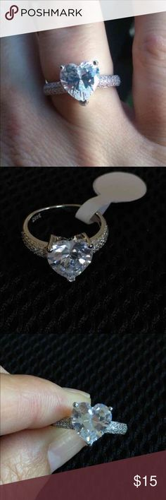 Heart 925 Sterling Silver Plated Engagement Ring Brand New Gorgeous heart-shaped CZ stone 925 Sterling Silver plated ring. Comes in a cute jewelry box. Jewelry Rings
