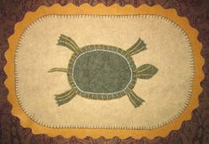 Sarah's wool applique painted turtle. Pattern by UpTheCreekOriginals.