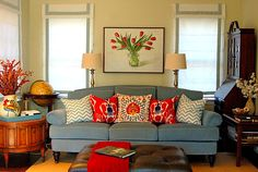 blue sofa, yellow wall, red accents...don't really like...maybe I need to paint my walls....ha!