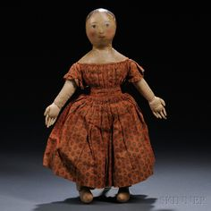 Oil-painted Cloth Girl Doll, possibly Izannah Walker, Rhode Island, c. 1860s, oil-painted cloth head and sloped shoulders featuring blue eyes, pink mouth and cheek coloring, brown hair with tendrils