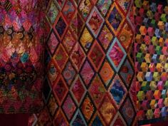 A cornucopia of colourful Quilts by Kaffe Fassett.