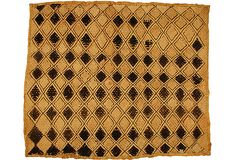 Late-20th-century Kuba cloth, made with raffia woven in a geometric pattern.