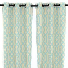 Add an interesting touch to your windows with these teal curtain panels. With hues of teal and cream and bronze metal grommets, these curtain panels are sure to look great on your windows!