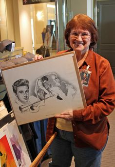 Nashville-based Betty Harper, the official artist for Elvis Presley Enterprises, has created more than 200,000 drawings of Elvis. She sold some of her prints in the Guest House gift shop on March 4, 2017, during the opening weekend of Elvis Presley's Memphis. Here, she holds a print of the artwork the City of Memphis used on a 1978 billboard on Elvis Presley Boulevard on the first anniversary of his death.