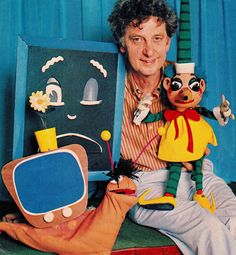 "MR. SQUIGGLE & FRIENDS (1959-1999) 41 seasons. Was Australia's longest running children's series. Norman Hetherington (b1921 d 2010 aged 89) & Mr.Sqiggle. Also Grumpy Blackboard ""Hurry up!"" and Gus the Snail. Viewers sent in a squggle, & Mr. Squiggle would make it into a picture, whilst upside down. Norman used one hand to manouver Mr.Squiggle & the other to draw with the big pencil in Mr. Squiggle's nose. Then Rocket would return Mr.Squiggle to the Moon. Woman's Day clipping (minkshmink)"