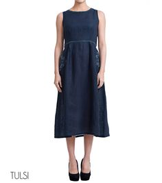 Linen Dress Round neck, sleeveless long dress Box pleat detailing on the front Stitch detailing at the neck line and waist line Placement embroidery on the side pockets and backyoke Button detailing at the back  ...