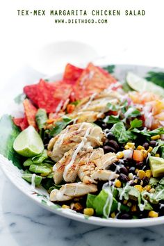 Tex-Mex Margarita Chicken Salad: Tender and tangy chicken marinated in flavors of margarita mix and lime, served atop a beautiful, colorful tex-mex salad.