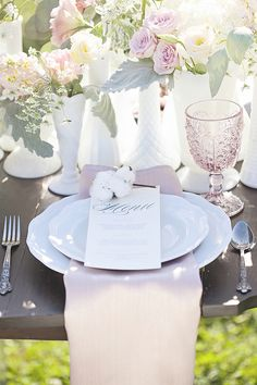 table decor and place setting inspiration for wedding reception #pastelflorals #weddingreception #weddingchicks http://www.weddingchicks.com/2014/01/27/pastel-sheep-wedding-inspiration