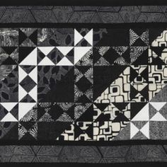 With clever fabric placement in each star block in a graphic, gift-worthy table runner, quilt tester Laura Boehnke created the illusion of diagonal stripes. The black-and-white batiks are from Hoffman California Fabrics.