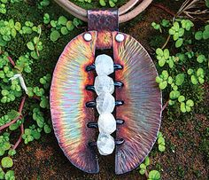 Eos Gemstone Pendant Workshop Fee:  $35 Instructor: Kat Clark Saturday, October 31 (1-4pm) Eos, the Greek goddess of the dawn awakens us each day and the texture of this pendant is reminiscent of a sunrise. Learn cold working to texture and join metal, use a wire wrap technique to embellish, and finally a patina technique to create a range of colors. Using birthstones would make this a very special piece. Sheet metal experience is helpful but not required. Materials list.