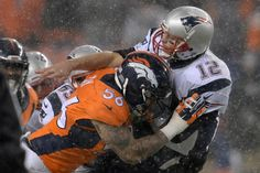 . DENVER, CO - NOVEMBER 29: Tom Brady (12) of the New England Patriots is hit by Shane Ray (56) of the Denver Broncos after releasing the ball in the third quarter. The Broncos played the New England Patriots at Sports Authority Field at Mile High in Denver, CO on November 29, 2015. (Photo by Andy Cross/The Denver Post)