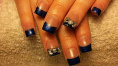 Blue glitter acrylic nail tips with 3D silver glitter bows