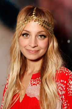 Bedazzled: Nicole loves a good headband, and she coupled this gold one with beachy waves and winged liner in 2009.